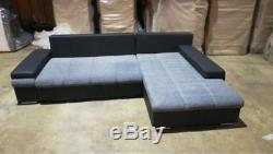 Clearance leather & fabric corner sofa with bed & storage in black grey