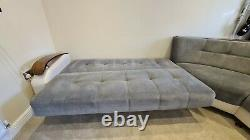 Corner sofa with two click clack fold down beds and storage