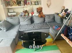 Grey corner sofa bed with storage