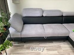 Used gray and black corner sofa bed with storage box and sleeping function