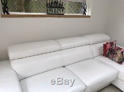 White leather corner sofa bed